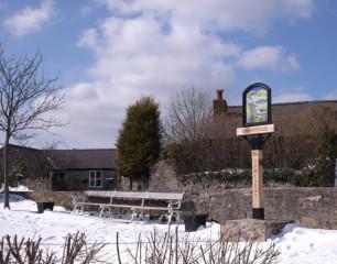Village Sign in Snow